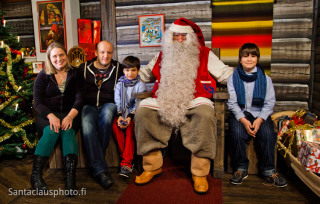 Family meeting Santa Claus in Christmas House in Rovaniemi Lapland
