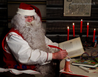 Santa Claus reading a book in Santa Claus' House in Rovaniemi