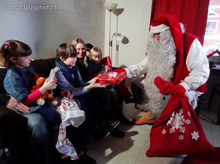 Santa Claus visiting Santa Claus Holiday Village With Gifts